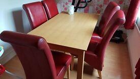 Dinning room hard wood table six seater