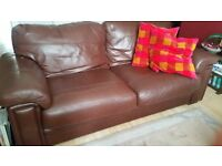 Harvey's Two-Seatwer Brown Leather Sofa