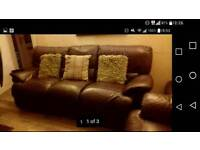 Three piece brown leather suite with recliners £100