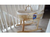 Used moses basket with hood, stand and brand new mattress sheets
