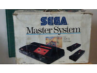 Boxed Sega Master System with light gun and 16 games