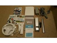 Wii console, Mario Kart Wii & Wheel & other games.