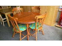Circular dining table with 4 cushioned chairs
