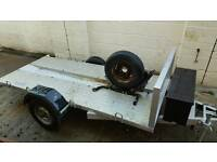 Motorcycle trailer with chock, ramp, lock box, lights and new tyres