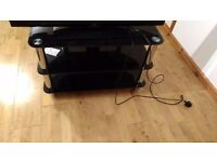 Good condition black glass tv stand