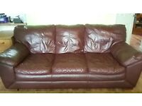 leather sofa, scratched from cats but still comfy and in okay condition