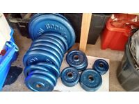 75 kgs of iron weight plates plus bars