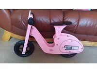 Pink wooden bike
