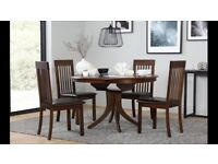 Nearly New Fully Assembled Round Dark Wood Extending Dining Table With 4 Matching Chairs