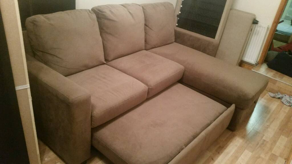 Corner Sofa Bed. Was950 now only300Delivery availablein Barking, LondonGumtree - Corner sofa bed. Comfortable brown cord type material. In very good condition. Easily comverts into large double size bed. Can sleep 2 adults easily. Left side corner sofa. Has understorage space. Can come apart into pieaces for easy transportation...