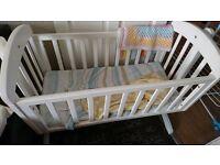 White Mamas and Papas rocking wooden crib
