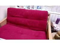 Red corduroy bed settee. Very good condition. Easy fold down offers accepted