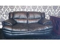 Black leather sofas in mint condition. Selling as moved home and brought new ones so no space