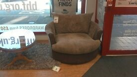 brown fabric and faux leather cuddle chair - British heart foundation