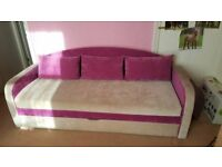 Beautiful sofa bed in pink and beige with storage