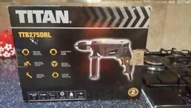 Titan percussion drill