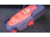 Flymo electric lawnmower. 320 model. Rotary metal blade cutting. Mower