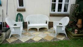White wicker sofa and chairs