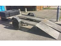 flat bed trailer with chequered plate ramps and large box on front was used for quad