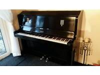 Upright piano in black,great condition..