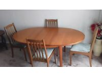 Teak extending table with 4 chairs