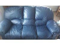Navy leather sofa and matching armchairs