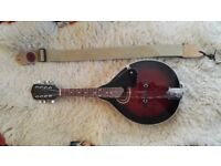 Antoria mandolin, hardly used, mint condition. Dark red with strap and case and book.