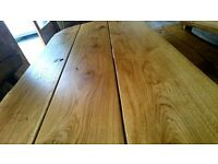 Solid oak handmade dining table and two benches set.