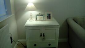 Lovely very solid piece of furniture with drawer, cupboard and lift up top.