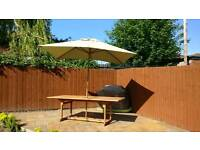 Garden table, 6 chairs and a parasol
