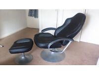reclining black and chrome chair with footstool