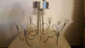 BEAUTIFUL SWIRLY SILVER CHANDELIER WITH FITTING AND COMES WITH LIGHT