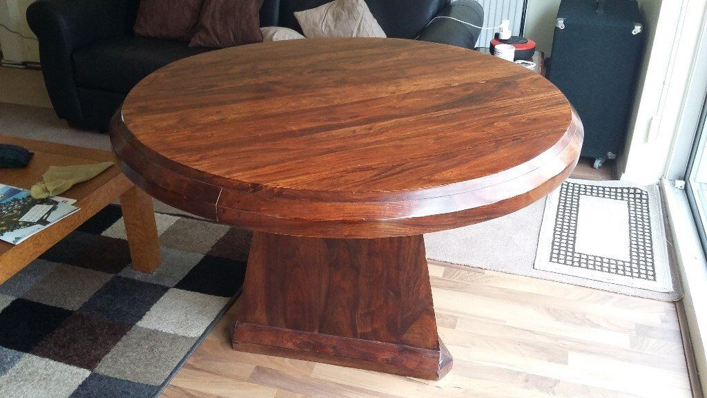"""Unusual dining tablein Liphook, HampshireGumtree - Stylish dining table in the style of Hatzi designs. Contemporary shape, with round top and heavy triangular base. Beautiful woodgrain. Very good condition. Top comes off for transport. Diameter 48"""" (120cm) Height 30"""" 76cm)"""