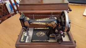 Vintage Singer Sewing Machine (1904) in good working order. With original wooden case.