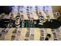 K2 BRIGADE SNOWBOARD WITH DAKINE BINDINGS AND DC JACKET