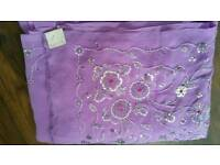 A brand new lilac /purple sari and blouse with tag