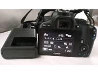 Canon 100D DSLR plus 28-80 ef lens
