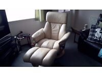 For sale is my reclining chair and stool real leather the chair also swivels