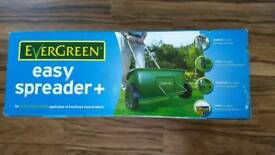Evergreen seed spreader