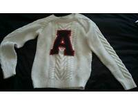 Cream Jumper age 9 - 10 years. Letter A