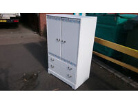 White flowered patterned tallboy with double drawer