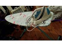 Steam iron and ironing board