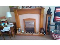 Oak fire surround with electric inset. Reasonable condition. Very heavy