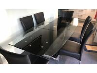 Glass topped extendable dining table and six chairs