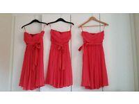 Three Coral Monsoon Bridesmaid dresses