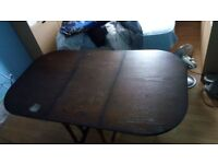 Nice brown polished dining table with 4 chairs