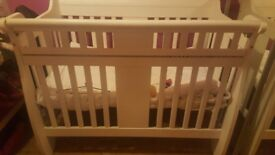 Cot/Toddler Bed white study and can be used from birth to 5/6years. Sides are removed to make a bed.