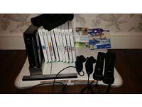 Wii Black, Sensor Bar, Wii Fit Board, 2 x Controllers, 2 x Nunchucks + Games