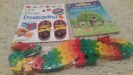 Brand new wooden welsh alphabet puzzle and 2 new welsh sticker books