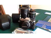 Olympus OM camera kit inc extra 150 zoom lens, flash, strap, cases and instns.